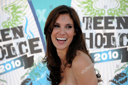 """Daniela Ruah arrives at the Teen Choice Awards on in Universal City, Calif. The Eurovision Song Contest appears to have heard its critics. After being chided by some for picking three male hosts for last year's competition, this year's event will feature four female presenters it was announced on Monday Jan. 8, 2018. The organizers say the May finals in Lisbon will be hosted by Daniela Ruah, a star on the hit television show """"NCIS: Los Angeles,"""" and three women known for their TV work in Portugal: Filomena Cautela, Silvia Alberto and Catarina Furtado"""
