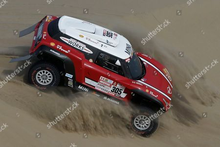 Driver Mikko Hirvonen, of Finland, and co-driver Andreas Schulz, of Germany, race their Mini during the third stage of the 2018 Dakar Rally between Pisco and San Juan de Marcona, Peru