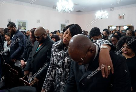 Family members and other mourners attend a service for fire victims Holt Francis; his wife, Karen Stewart-Francis, 37; their daughters, Kylie, 2, and Kelesha, 7; and their cousin, Shawntay Young, 19, in New York. The family members died in a fatal fire in the Bronx borough of New York that took a total of thirteen lives on Dec. 28, 2017
