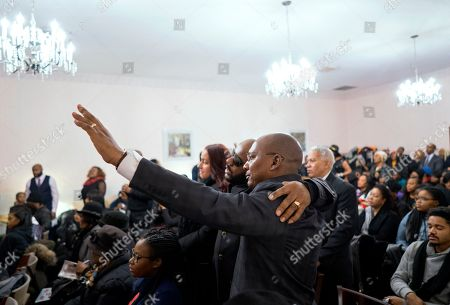 Stock Picture of Mourners attend a service for fire victims Holt Francis; his wife, Karen Stewart-Francis, 37; their daughters, Kylie, 2, and Kelesha, 7; and their cousin, Shawntay Young, 19, in New York. The family members died in a fatal fire in the Bronx borough of New York that took a total of thirteen lives on Dec. 28, 2017