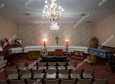 The closed caskets of fire victims Holt Francis; his wife, Karen Stewart-Francis, 37; their daughters, Kylie, 2, and Kelesha, 7; and their cousin, Shawntay Young, 19, rest at funeral home following a service, in New York. The family members died in a fatal fire in the Bronx borough of New York that took the lives of over a dozen people on Dec. 28, 2017