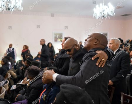 Mourners attend a service for fire victims Holt Francis; his wife, Karen Stewart-Francis, 37; their daughters, Kylie, 2, and Kelesha, 7; and their cousin, Shawntay Young, 19, in New York. The family members died in a fatal fire in the Bronx borough of New York that took a total of thirteen lives on Dec. 28, 2017
