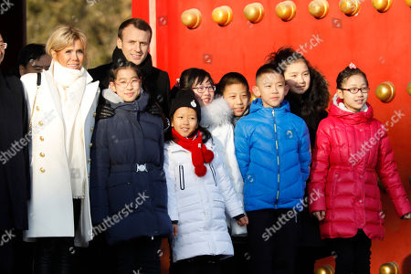 Emmanuel Macron, Brigitte Macron. French President Emmanuel Macron, second left, and his wife Brigitte Macron, left, pose with Chinese and French school children during their visit to the Forbidden City, in Beijing Craig McLachlan