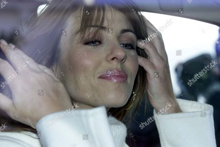 British Actress Liz Hurley Leaves Her Home In London...british Actress Liz Hurley Smiles At Photographers As She Leaves Her Home In West London November 9 2001. Hurley Announced Yesterday That She Is Expecting Her First Baby In April Next Year With Her American Film Producer Boyfriend Stephen Bing.
