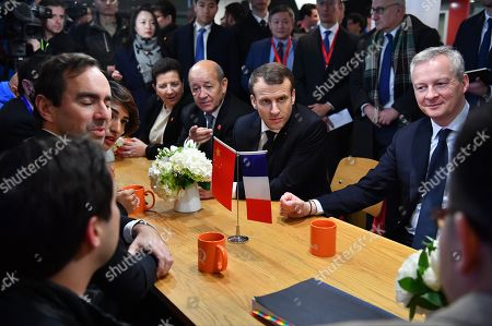 French President Emmanuel Macron flanked by foreign minister Jean Yves le Brian and Economy minister Bruno Le Maire visits Soho 3Q headquarters in Beijing