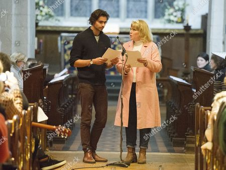 Stock Picture of Tom York And Sara Crowe Reads To The Congregation Of Godalming Church They Are Making A Special Appearance In Godalming Church For A Carol Service To Support Mane Chance Sanctuary.
