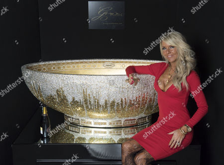 Celia Sawyer 'four Rooms' Tv Presenter And Interior Decorator With Robert Grace. Celia Has Been Commissioned To Produce The Most Expensive Bath Of All Time. It Costs ñ00 000 And Is Studded With Diamonds. Picture Shows Robert Grace Inspecting The Bath. The Bath Has Been Designed By (robert) Grace Of London 13.12.16.