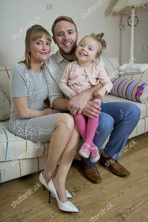 Stock Picture of Lucy And Adam Mason And Their Daughter Daisy Who Has Cerebral Palsy And Is One Of The Stars Of The Channel 4 Show ' Secret Lives Of 5 Year Olds'.