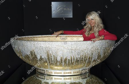 Bathtub £100 000 More If You Want To Add Taps From Interior Designer Celia Sawyer Pictured Here Trying It Out For Size. She Worked Closely On The Design With Ôsuper-luxury Sanitary Ware' Specialist Robert Grace And His Team Of Craftsman At His Studio In Epping Essex. The Bath Has Been Designed By (robert) Grace Of London Writer: Mark Palmer.