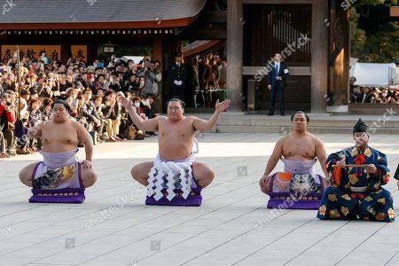 Sumo wrestler Hakuho Sho (2nd L) performs the Dezuiri, ring-entering ceremony, at the Meiji Shrine, Tokyo, Japan.