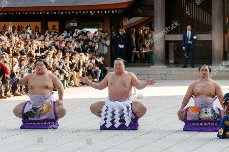 Sumo wrestler Hakuho Sho (C) performs the Dezuiri, ring-entering ceremony, at the Meiji Shrine, Tokyo, Japan.