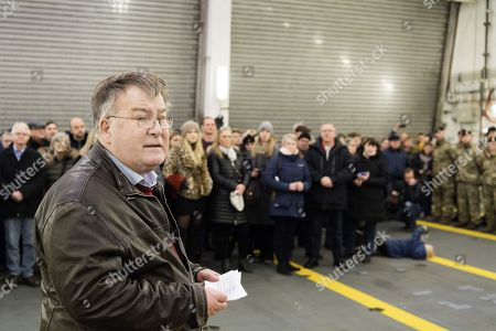 Danish minister of defense Claus Hjort Frederiksen (L) gives a speech to soldiers as the Royal Danish Navy warship, an Absalon-class support ship 'Esbern Snare' leaves the Korsoer naval base in Denmark to Estonia in Korsoer, Denmark, 209 January 2018. The warship, carrying infantry fighting vehicles, is part of the Danish contribution to the Nato's Enhanced Forward Presence in the Baltic Sea.