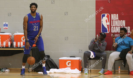 Mamadou Sakho of Crystal Palace watches the Philadelphia 76ers training with Joel Embiid on the ball during the NBA London event at City Sports with the Philadelphia 76ers tahead of there raining session, on 9th January 2018 at City Sports, London (