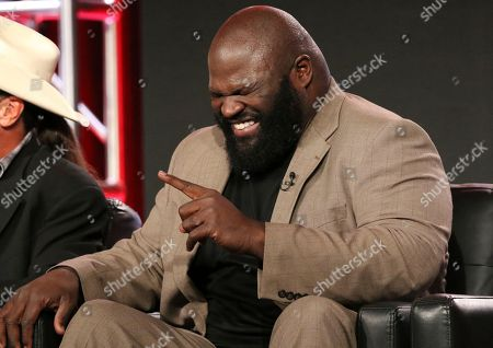 """Mark Henry laughs in the """"WWE Monday Night Raw: 25th Anniversary"""" panel during the NBCUniversal Television Critics Association Winter Press Tour, in Pasadena, Calif"""