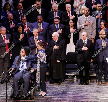Eric LeGrand, bottom left, leads the Pledge of Allegiance during a ceremony in Trenton, N.J., . New Jersey's 120-member Legislature has formally been sworn in and is starting its new session. New and returning lawmakers in the 80-member Assembly and 40-member Senate took their oaths of office in Trenton on Tuesday