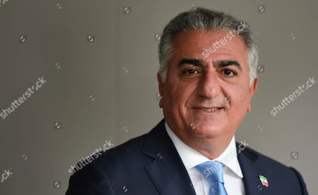 Stock Picture of Reza Pahlavi, the exiled son of Iran's last shah before the 1979 Islamic Revolution and a critic of the country's clerical leaders, pauses for a photo after an interview with The Associated Press in Washington