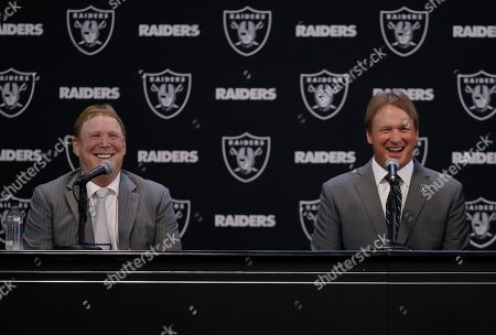 Jon Gruden, Mark Davis. Oakland Raiders new head coach Jon Gruden, right, smiles as he listens to a question from former Raiders player Charles Woodson, as he sits next to owner Mark Davis during an NFL football press conference, in Alameda, Calif