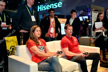 """US Soccer legends Brandi Chastain and Brian McBride play FIFA 18 on a 100"""" Hisense 4K Ultra HD Smart Laser TV at CES 2018, in Las Vegas. Hisense is a sponsor of the FIFA 2018 World Cup as well as US Soccer, and announced at CES that select televisions in the Hisense 2018 4K UHD line-up will exclusively feature the FOX Sport GO: 2018 FIFA World Cup Edition app allowing customers to watch live soccer matches in HDR"""