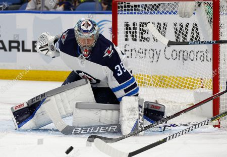 Winnipeg Jets goalie Steve Mason (35) makes a save during the first period of an NHL hockey game against the Buffalo Sabres, in Buffalo, N.Y