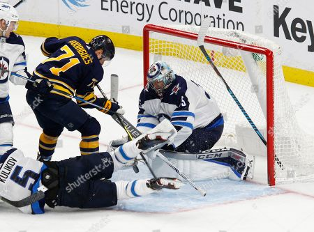 Buffalo Sabres forward Evan Rodrigues (71) is stopped by Winnipeg Jets goalie Steve Mason (35) during the third period of an NHL hockey game, in Buffalo, N.Y