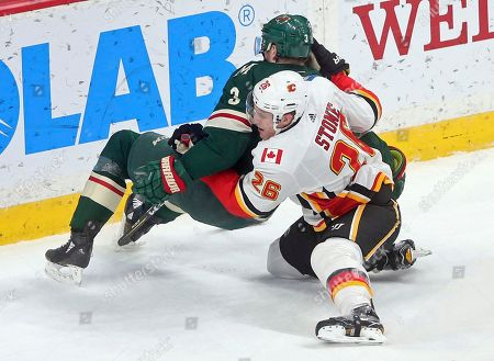 Michael Stone, Charlie Coyle. Calgary Flames' Michael Stone, right, brings down Minnesota Wild's Charlie Coyle in the first period of an NHL hockey game, in St. Paul, Minn