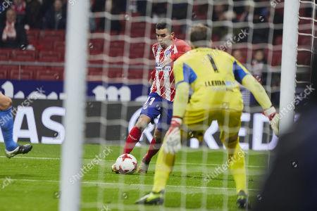 Angel Martin Correa of Atletico de Madrid and Diego Rivas Rego of Lleida Esportiu