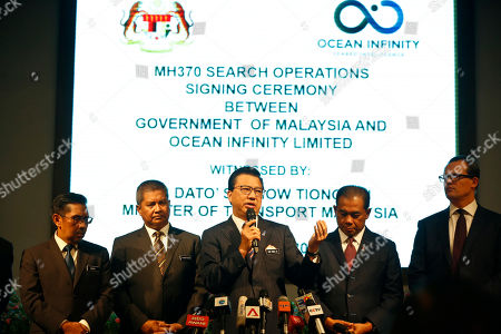 Malaysian Minister of Transport Liow Tiong Lai, center, speaks at a press conference during MH370 missing plane search operations signing ceremony between the government of Malaysia and the Ocean Infinity Limited in Putrajaya, Malaysia