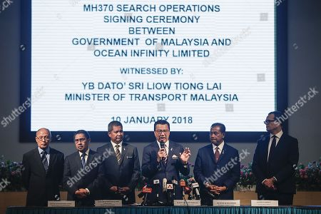 Stock Photo of Malaysia Transport Minister Liow Tiong Lai (C) speaks to journalist during a press conference after a signing ceremony between the Malaysian government and Ocean Infinity Limited at the Transport Ministry building, Putrajaya, Malaysia, 10 January 2018. The Malaysian government approved Texas-based company Ocean Infinity private company in a new attempt to find the wreckage of missing Malaysia Airlines flight MH370. The MH370 went missing from radar on 08 March 2014, while traveling from Kuala Lumpur, Malaysia to Beijing, China with 239 people aboard. Authorities from the governments of Australia, China and Malaysia suspended the search for the plane in January 2017 after conducting an extensive underwater search of a 120,000 square-kilometer area in the Indian Ocean.