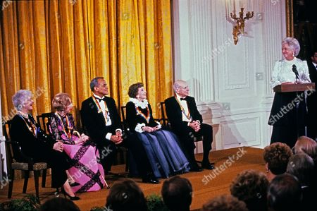 First lady Barbara Bush makes remarks during a ceremony for 1989 Kennedy Center Honorees in the East Room of the White House, in Washington, DC. The 1989 honorees are, from left to right: actress and singer Mary Martin, dancer Alexandra Danilova, singer and actor Harry Belafonte, actress Claudette Colbert, and composer William Schuman.