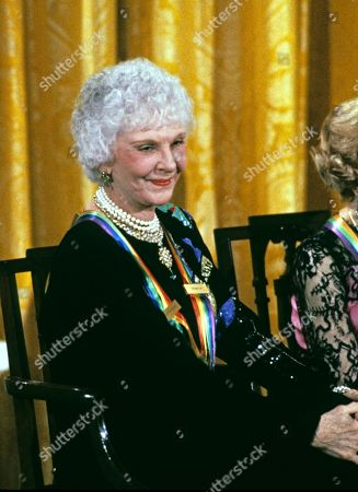 Actress and singer Mary Martin listens as first lady Barbara Bush makes remarks during a ceremony for 1989 Kennedy Center Honorees in the East Room of the White House, in Washington, DC. The 1989 honorees are: actress and singer Mary Martin, dancer Alexandra Danilova, singer and actor Harry Belafonte, actress Claudette Colbert, and composer William Schuman.