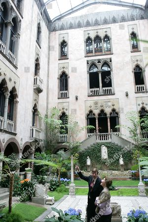 Stan Kozak, Chief Horticulturist of the Gardner Museum, guides Mrs. Laura Bush though a tour of the interior courtyard garden,, during a visit to the Isabella Stewart Gardner Museum in Boston. The museum is modeled after a 15th century Venetian Palazzo, turned inside out and surrounding the courtyard. Mandatory