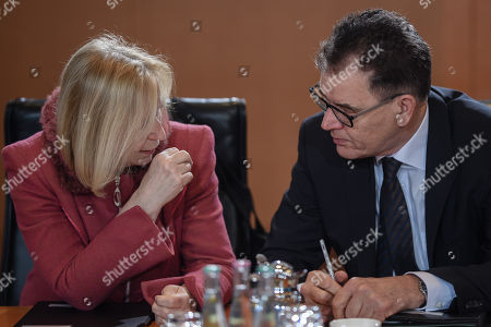 German Minister of Development Gerd Mueller (R) and German Education Minister Johanna Wanka talk at the beginning of the weekly meeting of the German Federal cabinet at the Chancellery in Berlin, Germany, 10 January 2018. During the 168th cabinet meeting, the ministers and the Chancellor are expected to discuss, among others, the results of the regulations on the parental leave and parental benefit.