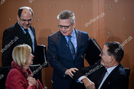 (L-R) German Agriculture Minister Christian Schmidt, German Education Minister Johanna Wanka, German Interior Minister Thomas de Maiziere and German Minister of Development Gerd Mueller talk during the beginning of the weekly meeting of the German Federal cabinet at the Chancellery in Berlin, Germany, 10 January 2018. During the 168th cabinet meeting, the ministers and the Chancellor are expected to discuss, among others, the results of the regulations on the parental leave and parental benefit.