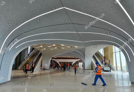 Workers clean the new Economic Zone metro station prior to the visit of Qatar's Prime Minister and Interior Minister Sheikh Abdullah bin Nasser bin Khalifa al-Thani, who inspected the ongoing metro rail works at the station in Doha, Qatar, 09 January 2018 (issued 10 January 2018). The Doha Metro is a rapid transit system in Qatar's capital and will be completed in 2020, right in time for the FIFA World Cup 2022.