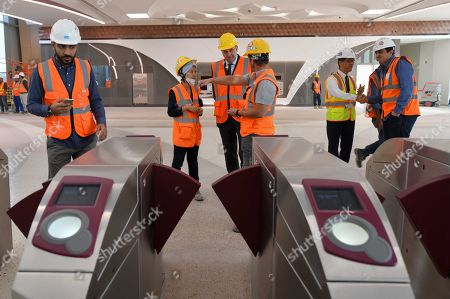 Stock Photo of Doha metro technical staff check the ticket gates at the new Economic Zone Station prior to the visit of Qatar's Prime Minister and Interior Minister Sheikh Abdullah bin Nasser bin Khalifa al-Thani, who inspected the ongoing metro rail works at the station in Doha, Qatar, 09 January 2018 (issued 10 January 2018). The Doha Metro is a rapid transit system in Qatar's capital and will be completed in 2020, right in time for the FIFA World Cup 2022.