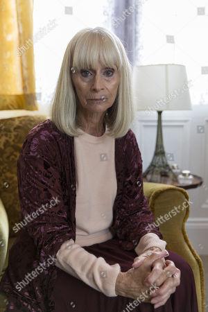 Rita Tushingham as Audrey Latham.