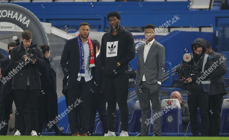 Basketball players for the Philadelphia 76ers Markelle Fultz, Joel Embiid and Justin Anderson on the pitch at full time