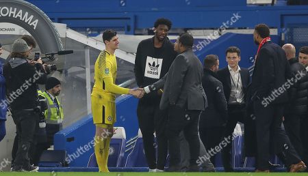 Chelsea goalkeeper Thibaut Courtois meets Joel Embiid of the Philadelphia 76ers