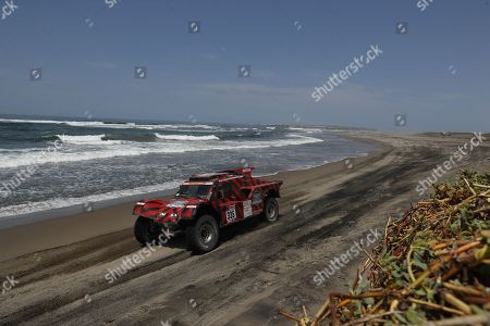 Eugenio Amos, from Italy, and Sebastian Delaunay, from France of Ford compete during the fifth stage of the 2018 Dakar Rally, between San Juan de Marcona and Arequipa, on the beach of Puerto Lomas, Peru, 10 January 2018.