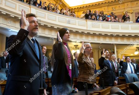 Danica Roem, David Reid, Cheryl Turpin. Del. Danica Roem, D-Prince William, second from left, the first transgender Delegate takes her oath of office along with Del. David Reid, D-Loudon, left, and Del. Cheryl Turpin, D-Virginia Beach, third from left, during opening ceremonies of the 2018 session of the Virginia House of Delegates at the Capitol in Richmond, Va