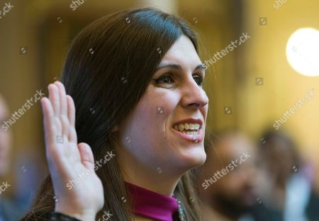 Del. Danica Roem, D-Prince William, the first transgender delegate, takes her oath of office during opening ceremonies of the 2018 session of the Virginia House of Delegates at the Capitol in Richmond, Va