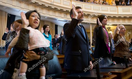 Danica Roem, David Reid, Cheryl Turpin, Kathy Tran. Del. Danica Roem, D-Prince William, second from right, the first transgender delegate, takes her oath of office along with Del. David Reid, D-Loudon, second from left, and Del. Cheryl Turpin, D-Virginia Beach, right, and Del. Kathy Tran, D-Fairfax, left, holding her sleeping daughter Elise, during opening ceremonies of the 2018 session of the Virginia House of Delegates at the Capitol in Richmond, Va