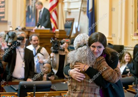 Danica Roem, Cheryl Turpin. Del. Danica Roem, D-Prince William, right, the first transgender delegate, hugs Del. Cheryl Tuprin, D-Virginia Beach, left, prior to opening ceremonies of the 2018 session of the Virginia House of Delegates at the Capitol in Richmond, Va