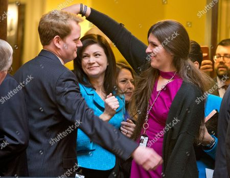 Danica Roem, Chris Hurst. Del. Danica Roem, D-Prince William, right, the first transgender Delegate, shares a hug with Del. Chris Hurst, D-Radford, prior to opening ceremonies of the 2018 session of the Virginia House of Delegates at the Capitol in Richmond, Va