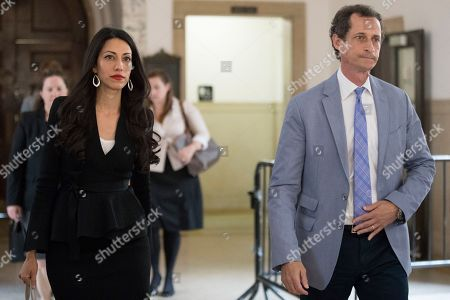 "Anthony Weiner, Huma Abedin. Former congressman Anthony Weiner, right, and his estranged wife, Huma Abedin, left, leave court in New York. The couple was supposed to appear before a Manhattan judge, but the judge said both sides had agreed to discontinue the case. Abedin filed a divorce from Weiner in May and listed it as ""contested,"" which meant they had to negotiate in front of a judge. But now the parties can re-file as ""uncontested"" and won't have to make their discussion public"