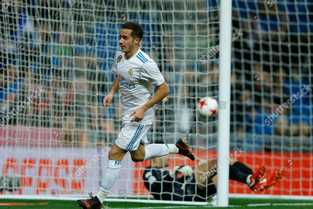 Stock Image of Real Madrid's Lucas Vazquez runs after scoring the opening goal past Numancia's goalkeeper Munir Mohand Mohamedi, on the ground, during the Spanish Copa del Rey round of 16 second leg soccer match between Real Madrid and Numancia at the Santiago Bernabeu stadium in Madrid