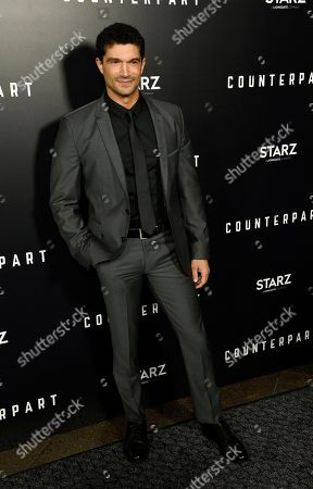 """Mido Hamada, a cast member in the new Starz series """"Counterpart,"""" poses at the premiere of the series at the Directors Guild of America, in Los Angeles"""