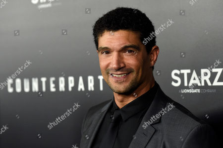 """Stock Photo of Mido Hamada, a cast member in the new Starz series """"Counterpart,"""" poses at the premiere of the series at the Directors Guild of America, in Los Angeles"""
