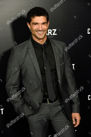 """Stock Picture of Mido Hamada, a cast member in the new Starz series """"Counterpart,"""" poses at the premiere of the series at the Directors Guild of America, in Los Angeles"""
