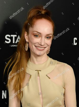 """Lotte Verbeek, a cast member in the new Starz series """"Counterpart,"""" poses at the premiere of the series at the Directors Guild of America, in Los Angeles"""